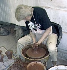 photo of Debra Ocepek throwing a pot on the potter's wheel