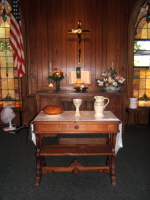 A photo of the altar display of the Otoe Congregational Communion Pottery set by Ocepek Pottery in Akron, Ohio. Photo courtesy of  Kingsley United Methodist Church, Kingsley, Mi., 