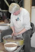 A photo of Debra Ocepek at the potter's wheel, Akron, Ohio