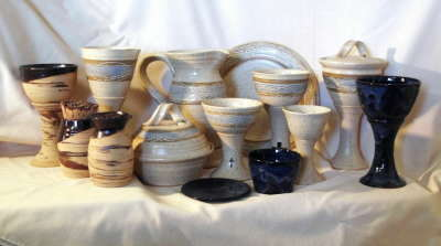 photo of all of our wheel-thrown travel communion sets