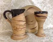 photo of Congregational Size Communion Set by Debra Ocepek of Ocepek Pottery Communionware, in Memorial Pattern