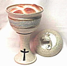 photo of pottery ciborium with bread baked inside
