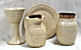 photo of portable chaplain communion set - goblet, paten, jug, jar - in Otoe glaze by Ocepek Pottery