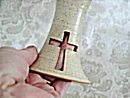 photo of carved cross on communion chalice